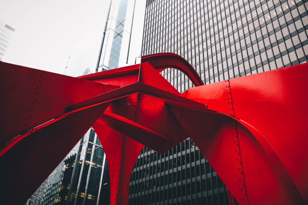 Ground image of red metal sculpture called Flamingo