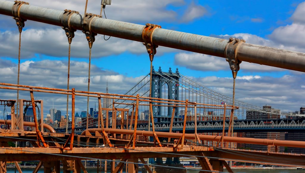 metal frames of bridge with New York city background