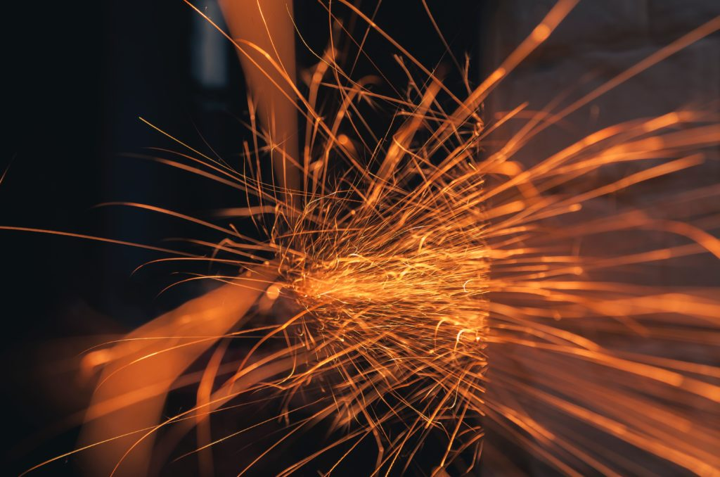 time lapse photography of sparks from metal working